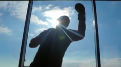 Boxer silhouette near the window Stock Footage
