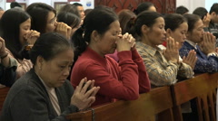 Sunday prayer in a Catholic church in Hanoi, Vietnam Stock Footage