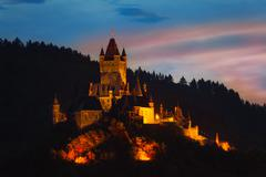Cochem Imperial Castle on mountain at night - stock photo