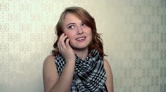 Teenage girl wearing checked scarf on phone call Stock Footage