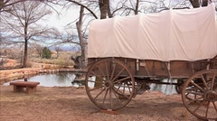 Covered Wagon Sits Next to Natural Spring Water Stock Footage