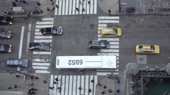 overhead downward view of intersection in Midtown Manhattan with cars people NYC - stock footage