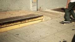 Skateboarder doing trick on sidewalk - stock footage