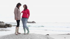 Two girls on the beach Stock Footage
