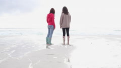 Two girls on the beach - stock footage