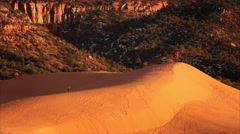 Hiker at Coral Pink Sand Dunes State Park in Utah Stock Footage