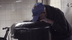 Man digging in garbage can in subway station in 4K New York City Stock Footage