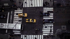 zooming out overhead view of crosswalk street tall building cars driving NYC - stock footage