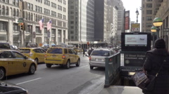 Woman enters 6 train subway station entrance Park Ave with Taxis stoplight NYC Stock Footage