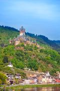 Cochem Imperial Castle, mountain and Mosel river - stock photo