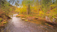 The water rushing on the small waterfall Stock Footage
