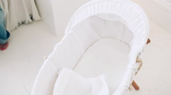 Mother placing baby in bassinet Stock Footage