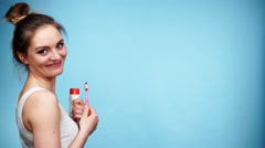 Woman holds toothbrush and paste for teeth cleaning 4K Stock Footage