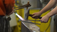 Working With Hammers Forging Hot Iron Stock Footage