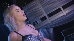 Dj girl in glowing top, mouse ears wave hands from heat. Nightclub. Slow motion - stock footage