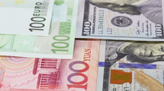Main word currency Yuan, US Dollar and Euro bank notes rotating - stock footage