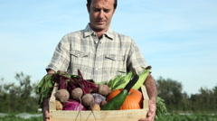Farmer holding crate of fresh vegetables Stock Footage