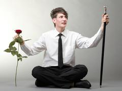 Portrait young man and rose enamoured love - stock photo