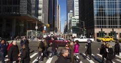 Crowd of people commuters walking crossing street New York Stock Footage