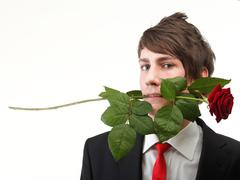 Young man, flower, red rose isolated Stock Photos