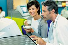 Couple in internet cafe - stock photo