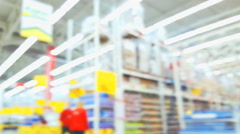 Supermarket store motion people with bokeh, blurred background - stock footage