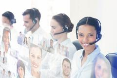 Composite image of business people with headsets using computers - stock photo