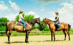 Women cowgirl and jocket riding horse. Activity. - stock photo