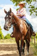 Western cowgirl woman riding horse. Sport activity - stock photo