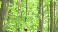 Four cyclists in forest Stock Footage
