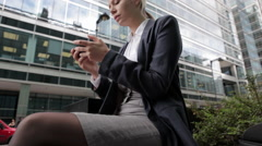 Businesswoman text messaging on cellphone in city - stock footage