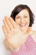Woman holding out hand Stock Photos