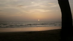 Writer typing on laptop during sunset at beach - stock footage