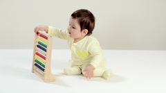 Baby boy playing with abacus Stock Footage