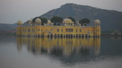 Jal mahal palace on lake at night in Jaipur India Stock Footage