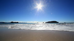 View out to sea in sunlight, Hahei, Waikato Region, New Zealand Stock Footage