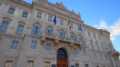 Trieste, Italy. Italian Roman architecture. European and Italy Flags - stock footage