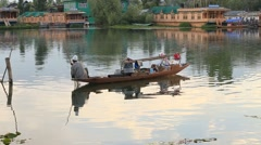 Lifestyle in Dal lake, people use small boat for transportation. Srinagar, India Stock Footage