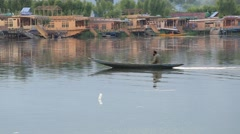 Lifestyle in Dal lake, people use small boat for transportation. Srinagar, India - stock footage