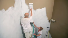 Stock Video Footage of Couple painting wall