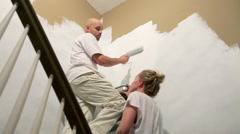 Couple painting wall Stock Footage