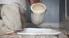Man pouring paint Stock Footage