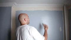 Man painting wall Stock Footage