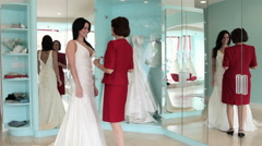 Daughter trying on wedding dress, mother putting on the tiara Stock Footage