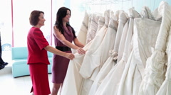 Mother and daughter looking at wedding dresses Arkistovideo