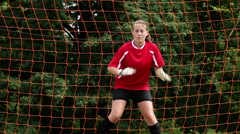 Girl goalkeeper being hit by ball Arkistovideo