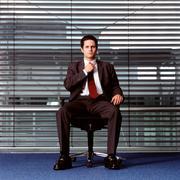 Businessman adjusting his tie Stock Photos