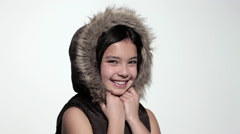 Happy girl wearing a furry hood - stock footage