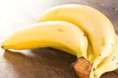 Banana on brown wooden background - stock photo