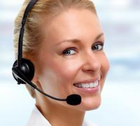 Smiling agent woman with headsets. Stock Photos